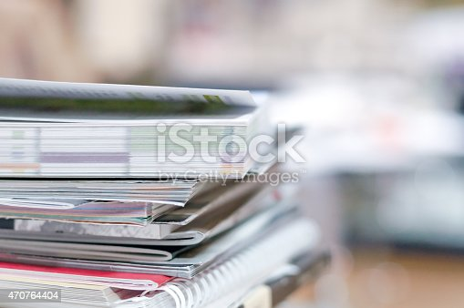 istock stack of magazines and brochures 470764404