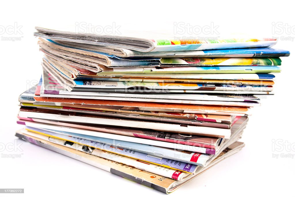 Stack of magazines isolated stock photo