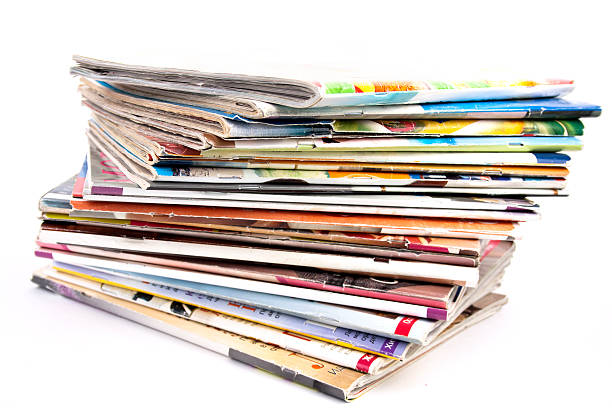 stack of magazines isolated - magazine stock photos and pictures