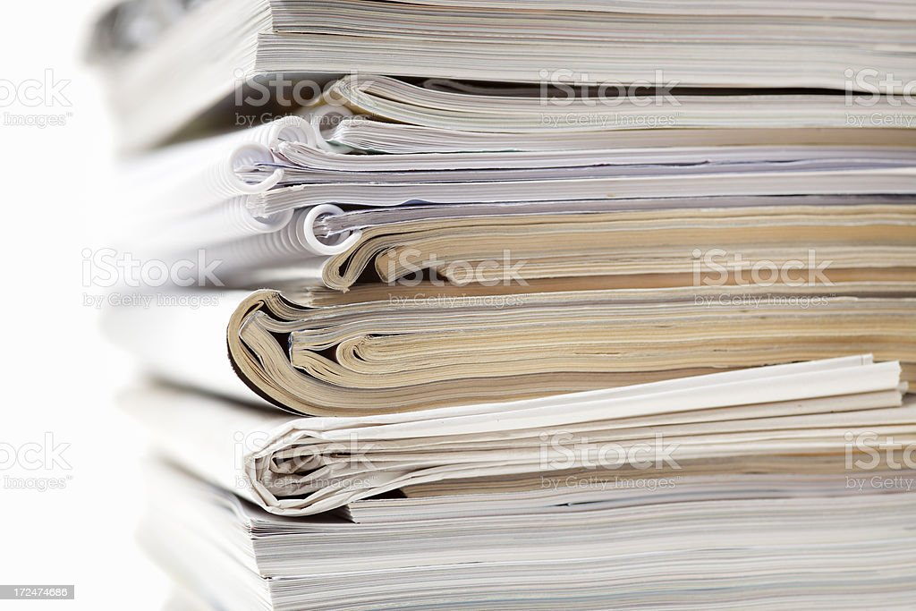 Stack of magazines, newspapers, and ring binders.  royalty-free stock photo