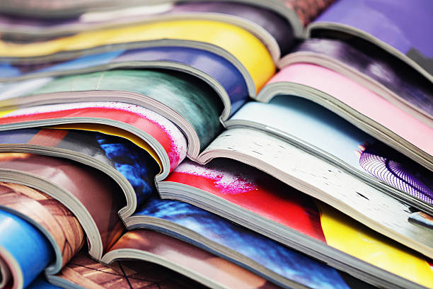stack of magazines - magazine stock photos and pictures