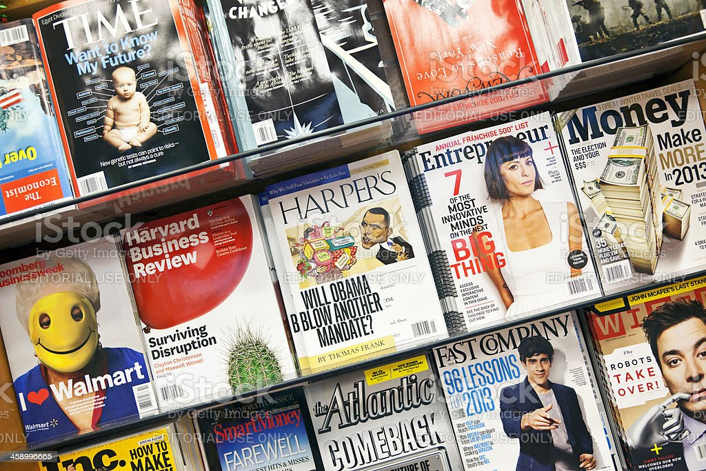 """Stack of magazines # 14 XXXL """"New York City, USA - December 17, 2012: Stack of popular magazines on the outside of the street side newsstand on Broadway Upper West. Time, Harvard Business Review, Money, entrepreneur, Harper's and New York magazines can be seen."""" 2012 Stock Photo"""