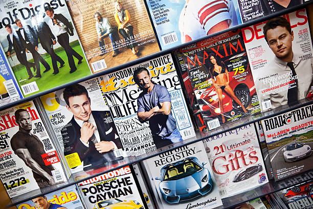 """Stack of magazines # 5 XXXL """"New York City, USA - December 17, 2012: Stack of popular magazines for men on the outside of the street side newsstand on Broadway Upper West."""" magazine rack stock pictures, royalty-free photos & images"""