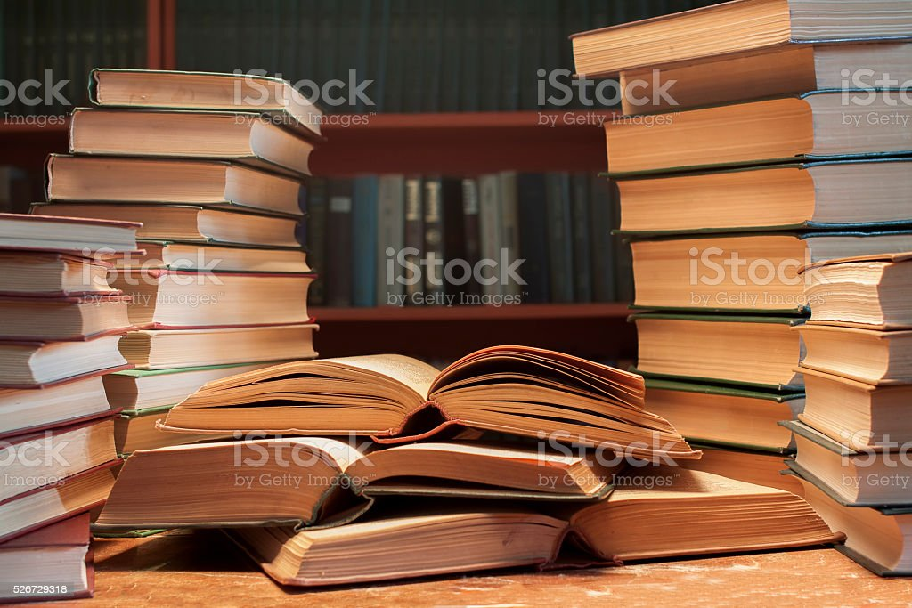 stack  of many old books on the table stock photo