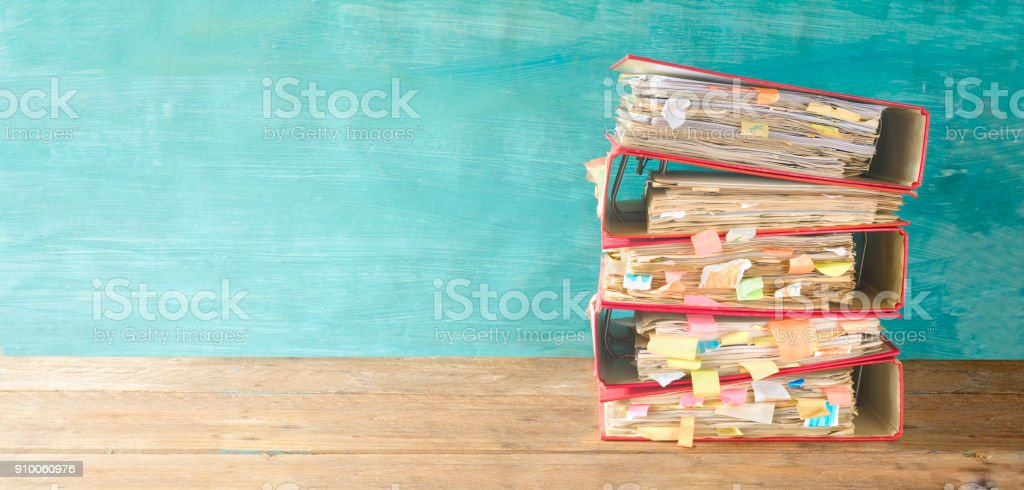 stack of messy file folders and documents,red tape concept,free copy space stock photo