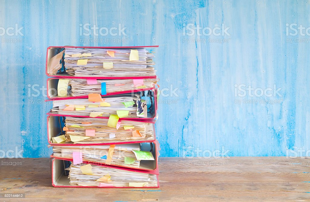 stack of messy file folders stock photo