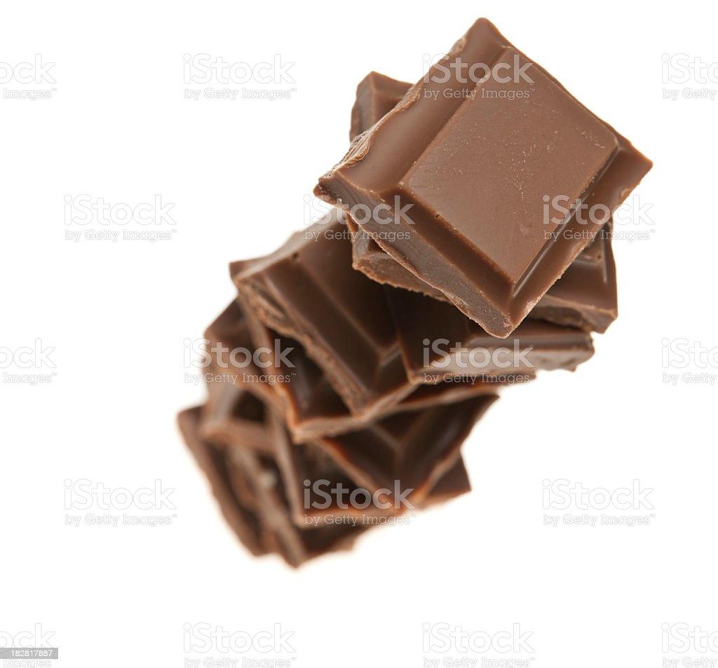Stack of milk chocolate chunks royalty-free stock photo