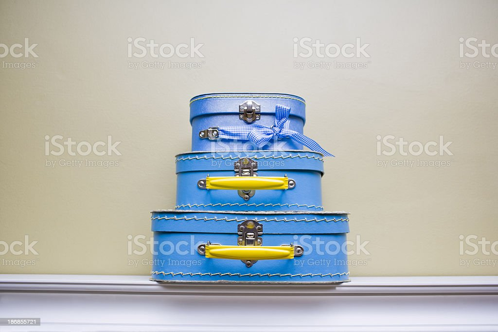 Stack of mini suitcases stock photo