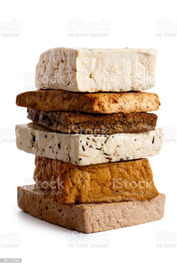 Stack of mixed tofu blocks isolated on white. stock photo