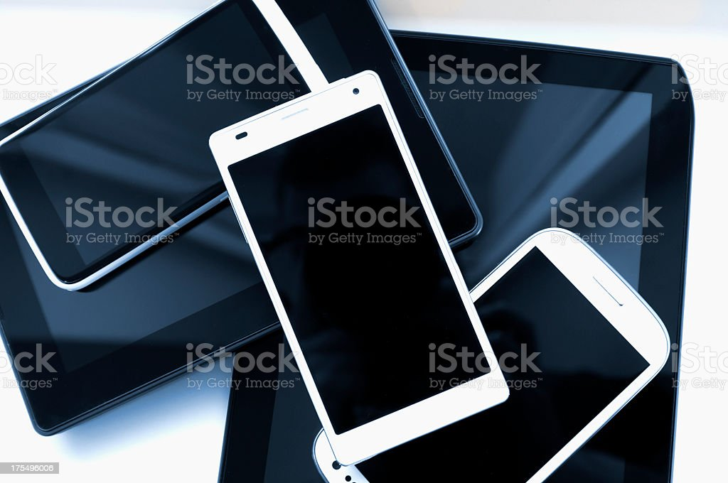 Stack of mobile phones and tablets on a white background stock photo