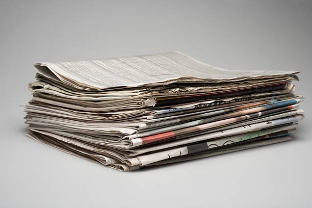 A stack of morning business papers stock photo