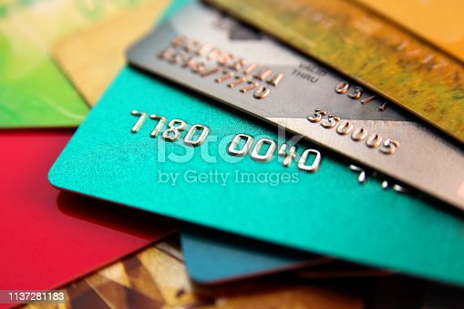 istock stack of multicolored credit cards, close up view with selective focus 1137281183