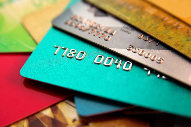 stack of multicolored credit cards, close up view with selective focus stock photo