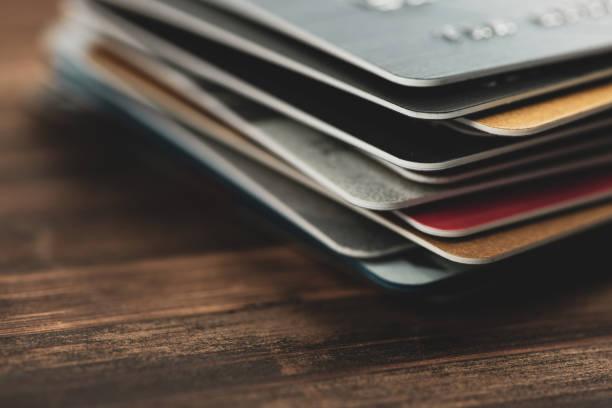 stack of multicolored credit cards close-up - credit card zdjęcia i obrazy z banku zdjęć