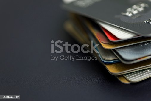 istock Stack of multicolored credit cards close-up 903663312