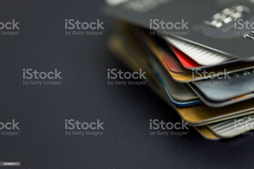 Stack of multicolored credit cards close-up stock photo