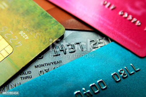istock Stack of multicolored credit cards close-up view with selective focus. 682285434