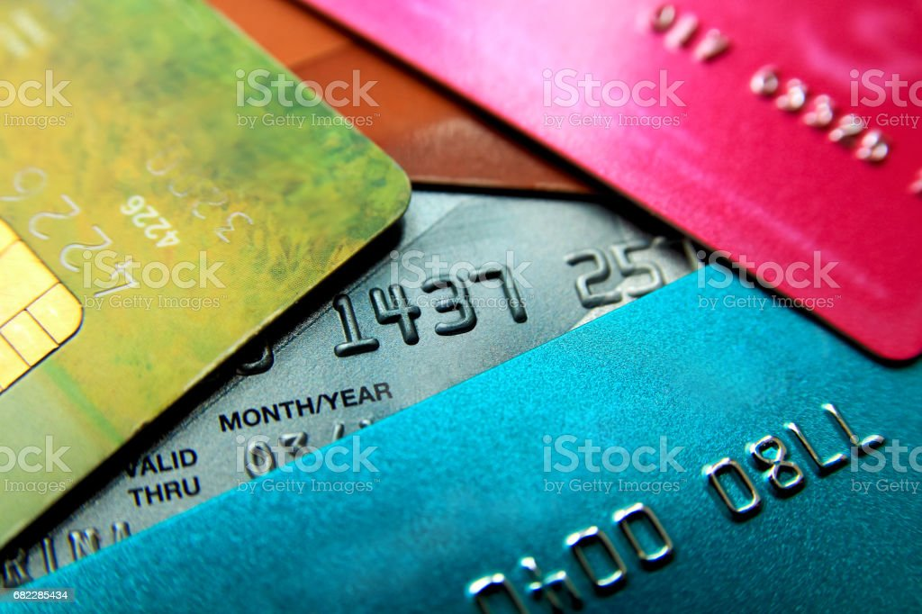 Stack of multicolored credit cards close-up view with selective focus. stock photo