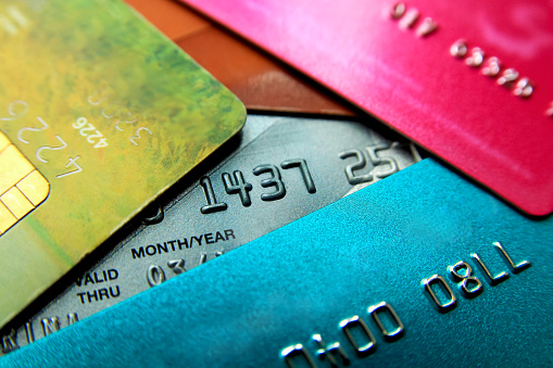Stack Of Multicolored Credit Cards Closeup View With Selective Focus Stock Photo - Download Image Now