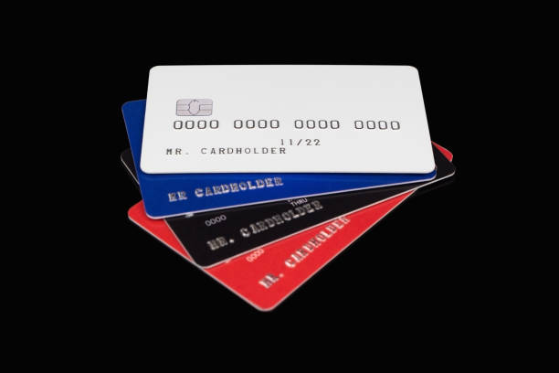 Stack of multicolored credit cards on black background stock photo