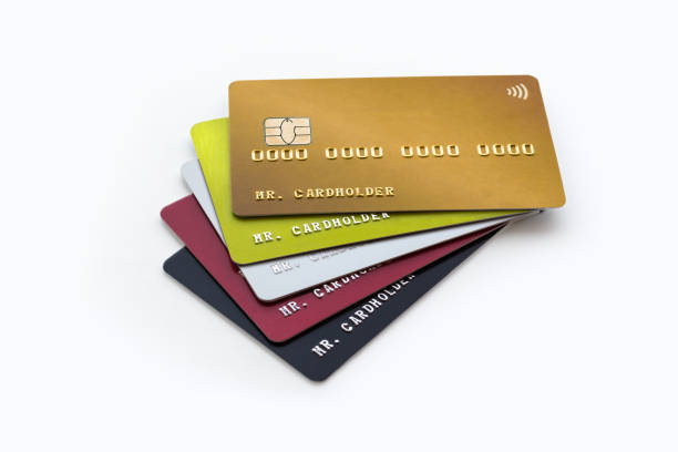 Stack of multicolored credit cards on white background stock photo