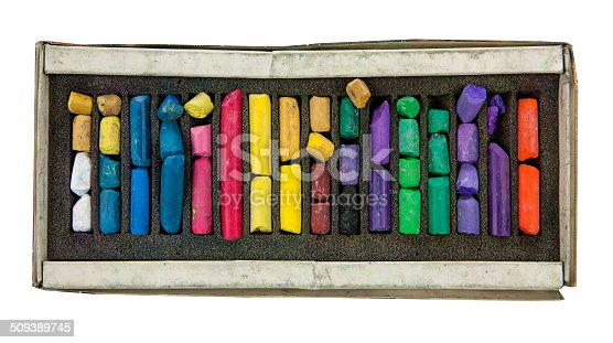 623300522 istock photo stack of multicolored pastel chalks on box isolated on white background 509389745