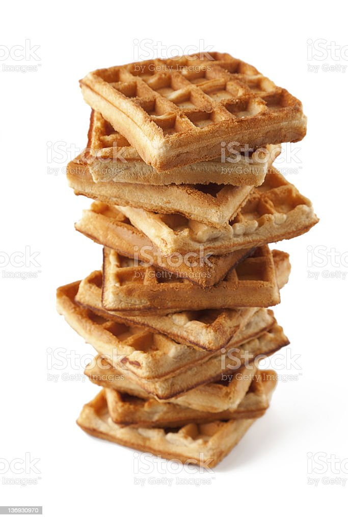 Stack of multiple waffles on a white background stock photo