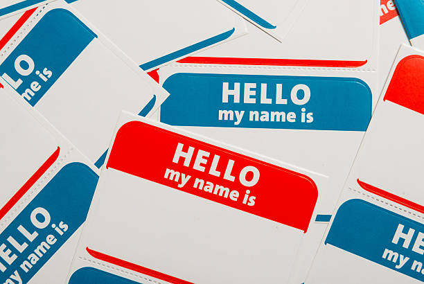 stack of name tags or badges - identity stock photos and pictures
