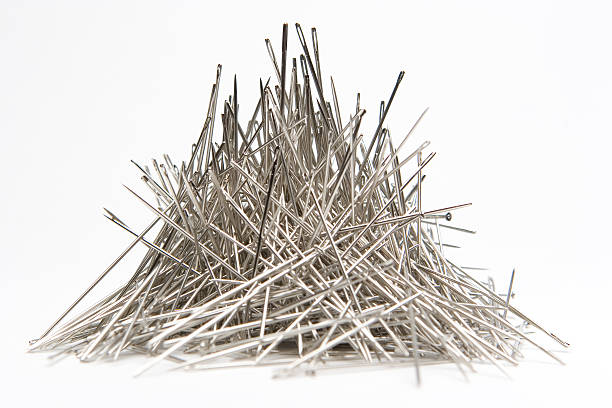 Stack of Needles  sewing needle stock pictures, royalty-free photos & images