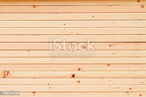New, 2x4 wood planks stacked on top of each other.