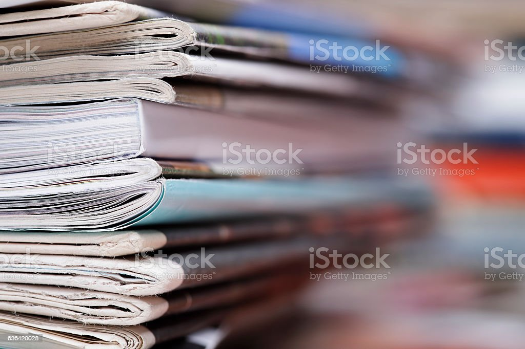 Stack of newspaper and magazines with copy space royalty-free stock photo