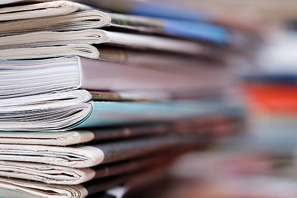 Stack of newspaper and magazines with copy space - Photo