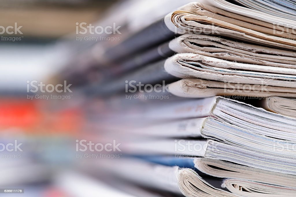 Stack of newspaper and magazines with copy space stock photo