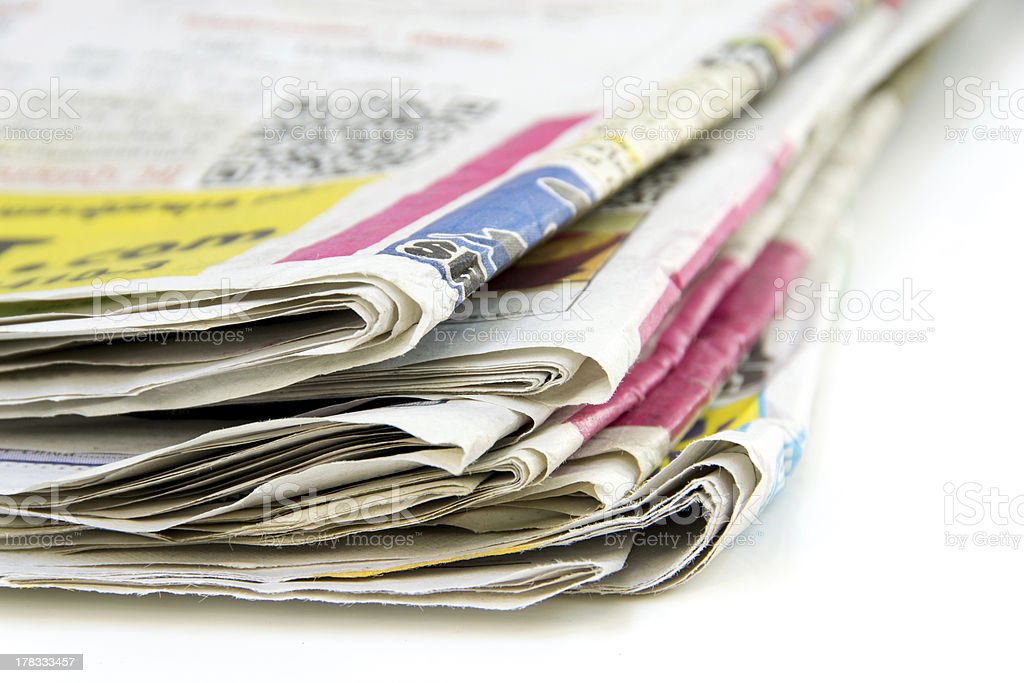 Stack of newspapers  on white background royalty-free stock photo