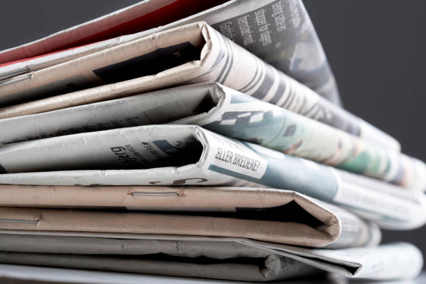 A stack of newspapers stock photo