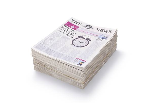 Stack of Newspapers... A small stack of newspapersaA For more newspaper images please click on the banner below... newspaper cutouts of bad news headlines stock pictures, royalty-free photos & images
