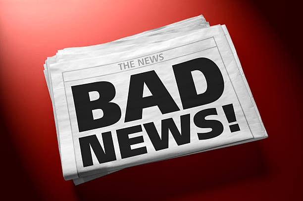 Stack of newspapers with headline BAD NEWS! Newspaper with BAD NEWS! headline on first page. Red  gradient background. Clipping path included for newspaper. newspaper cutouts of bad news headlines stock pictures, royalty-free photos & images