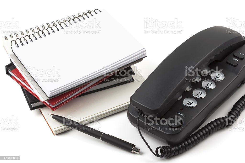 Stack of notebooks and black phone royalty-free stock photo