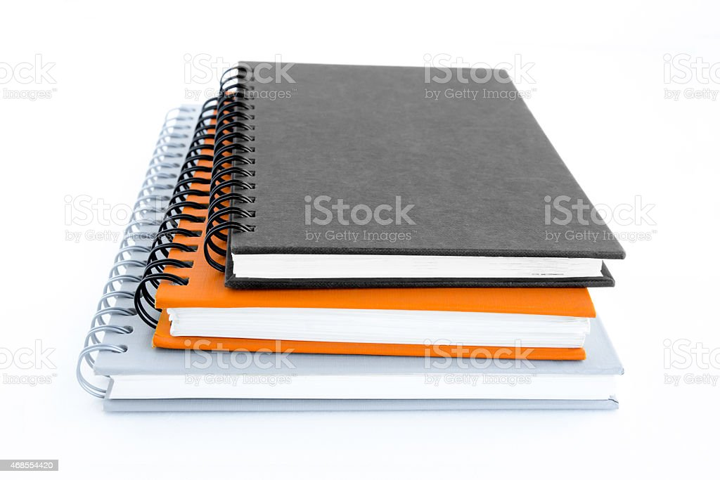 Stack of notebooks (or copybooks) on white background stock photo