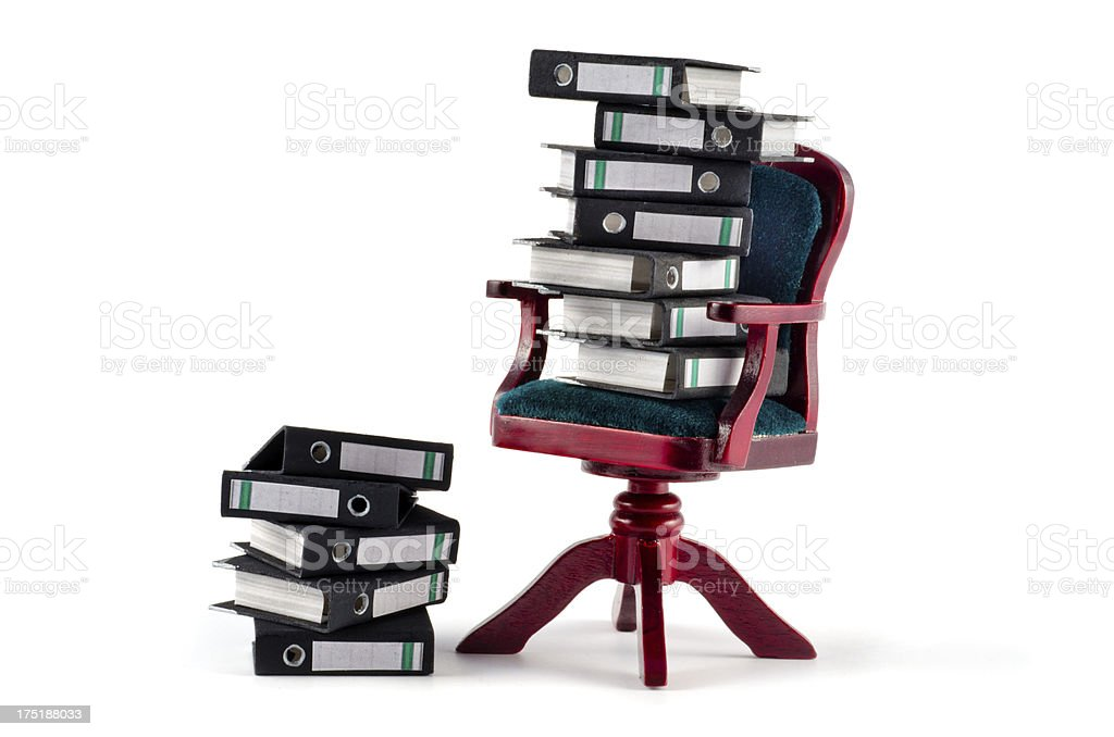 stack of office folders - ring binders on chair stock photo