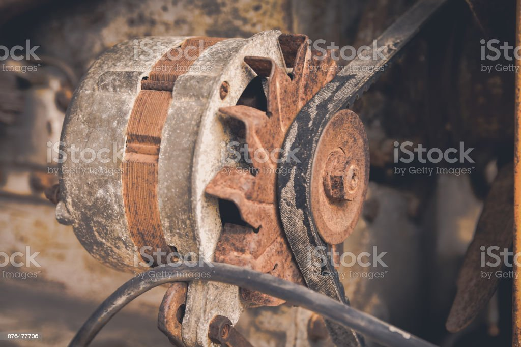 Stack of old and dirty motor generator. stock photo