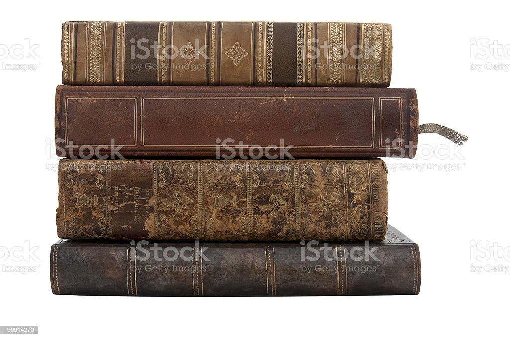 A stack of old antique books on a white background royalty-free stock photo