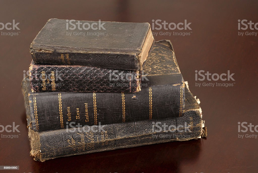 Stack of old bibles including some German ones royalty-free stock photo