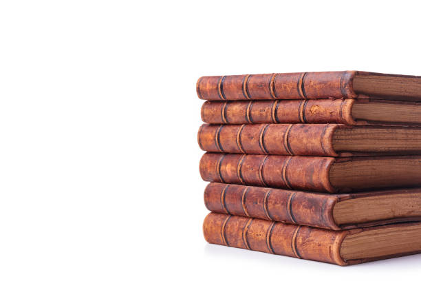 A stack of old books bound in brown leather, isolated on a white background. Space for text stock photo