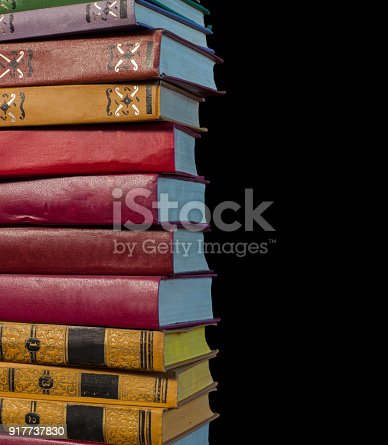 696860774 istock photo A stack of old books on a black background 917737830