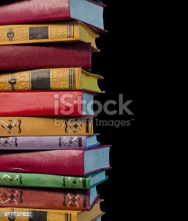 696860774 istock photo A stack of old books on a black background 917737832