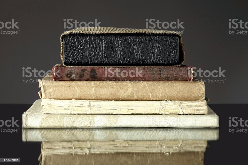 Stack of old books on dark royalty-free stock photo