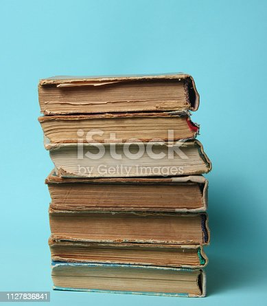 480762174istockphoto Stack of old books 1127836841