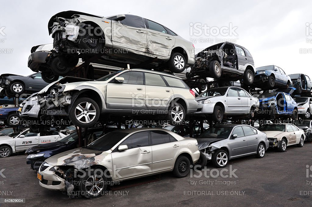 Stack of Old Damaged Cars stock photo