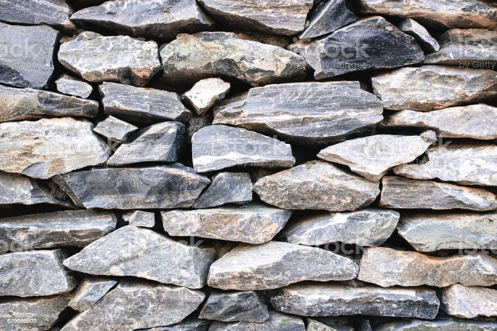 stack of old gray stone wall, for background or texture. royalty-free stock photo